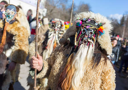 masquerade masks: Participants are participating in the International Festival of Masquerade Games Surva. The festival promotes variations of ancient Bulgarian and foreign customs and masks that are still alive today.