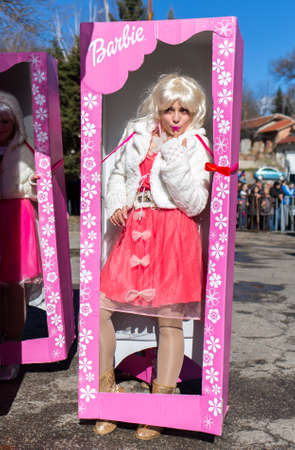 barbie: Pernik, Bulgaria - January 31, 2015: Participants are participating in the International Festival of Masquerade Games Surva. The festival promotes variations of ancient Bulgarian and foreign customs and masks that are still alive today. Editorial