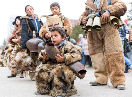 promotes: Pernik, Bulgaria - January 31, 2015: Participants are participating in the International Festival of Masquerade Games Surva. The festival promotes variations of ancient Bulgarian and foreign customs and masks that are still alive today. Editorial