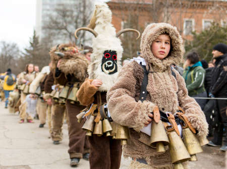 masquerade masks: Pernik, Bulgaria - January 31, 2015: Participants are participating in the International Festival of Masquerade Games Surva. The festival promotes variations of ancient Bulgarian and foreign customs and masks that are still alive today. Editorial