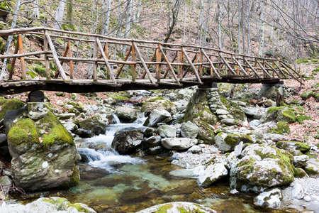 cumbria: Wooden bridge over a spring in the mountain.