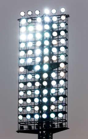 halogen lighting: Big stadium spotlight with many lamps turned on.