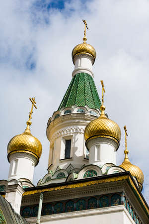 european ethnicity: The domes of the Russian Church St. Nicholas in Sofia, Bulgaria. The roof of the church is covered with green majolica tiles, which harmonise perfectly with the gold-plated domes.
