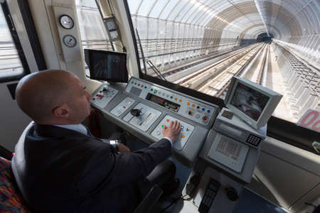 Sofia, Bulgaria - April 2, 2015: A subway train operator is driving the train for its first ride from the Sofia Airport extension. 新聞圖片