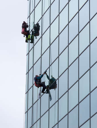 sanitation: Sofia, Bulgaria - April 7, 2015: Sanitation workers are cleaning the glass facade of a hotel in the center of Sofia. Editorial
