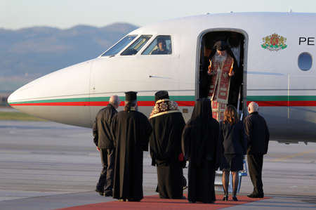 Sofia, Bulgaria - April 11, 2015: Christian priests are delivering the holy fire at Sofia airport. The sacred fire is taken from Jerusalem for Easter.