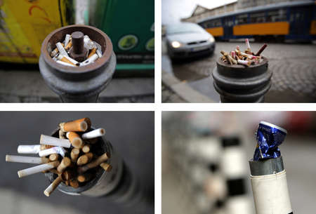 restrictive: Sofia, Bulgaria - March 29, 2013: Restrictive parking post is used as ashtray and space for waste for Sofias citizens cigarette buds.