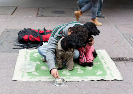 begging: An young man is begging on the ground of a main street in Budapest, Hungary.