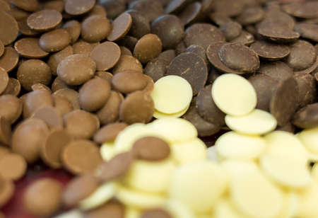 chocolate chips: White, brown and dark chocolate chips for sweets decoration.