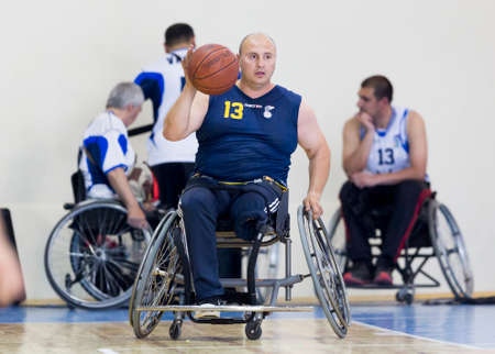 physically: Sofia, Bulgaria - May 16, 2015: Physically disabled people are playing basketball in the Sofias Cup tournament. Match between Sofia-Balkan (blue outfit) and Gavelin-Burgas.