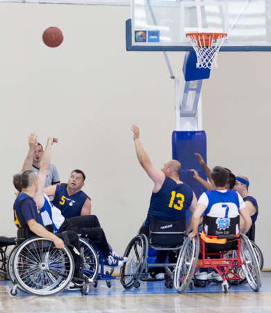 Sofia, Bulgaria - May 16, 2015: Physically disabled people are playing basketball in the Sofia's Cup tournament. Match between Sofia-Balkan (blue outfit) and Gavelin-Burgas.