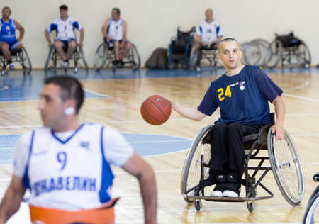 physical impairment: Sofia, Bulgaria - May 16, 2015: Physically disabled people are playing basketball in the Sofias Cup tournament. Match between Sofia-Balkan (blue outfit) and Gavelin-Burgas.