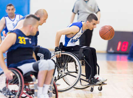 crippled: Sofia, Bulgaria - May 16, 2015: Physically disabled people are playing basketball in the Sofias Cup tournament. Match between Sofia-Balkan (blue outfit) and Gavelin-Burgas.