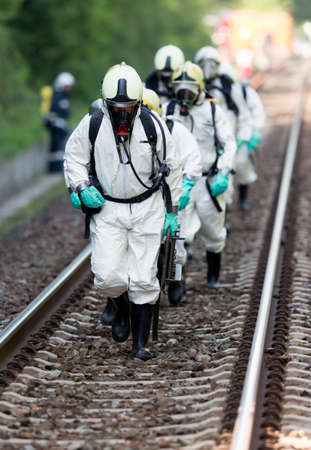 A team working with toxic acids and chemicals is approaching a chemical cargo train crash near Sofia. Teams from Fire department are participating in an emergency training with spilled toxic and flammable materials.