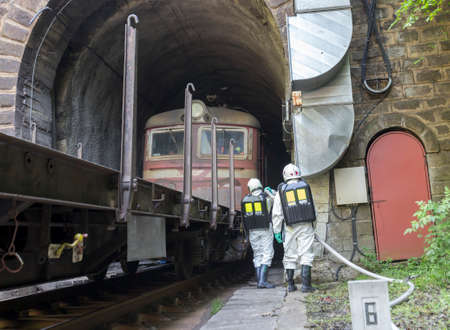 acids: A team working with toxic acids and chemicals is saving people from a chemical cargo train crash near Sofia. Teams from Fire department are participating in an emergency training with spilled toxic and flammable materials.