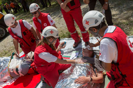 Sofia, Bulgaria - May 19, 2015: Volunteers from Bulgarian Red Cross organization are participating in a training with Fire department. They are assisting first aid to people involved in a train crash accident.