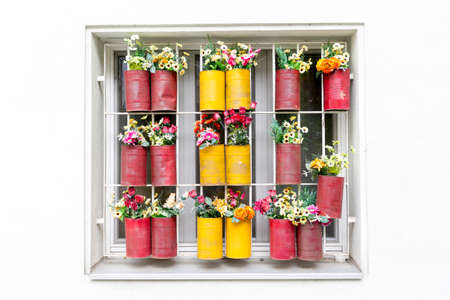flowerpots: Window with colorful flowerpots in Vienna, Austria. Stock Photo