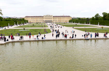schonbrunn palace: Vienna, Austria - May 1, 2015: Tourists are visiting the former imperial summer residence known as Schonbrunn Palace.