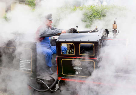 prater: Vienna, Austria - May 2, 2015: Tourists and a train driver enjoy a ride on the so called Liliputbahn. A gauge light railway in the Prater Park.