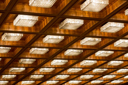 architectural lighting design: Many old vintage lamps on a wooden ceiling. Stock Photo