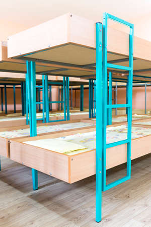 bunkbed: Kindergarten bedroom with small bunk beds with stairs for the kids. Stock Photo