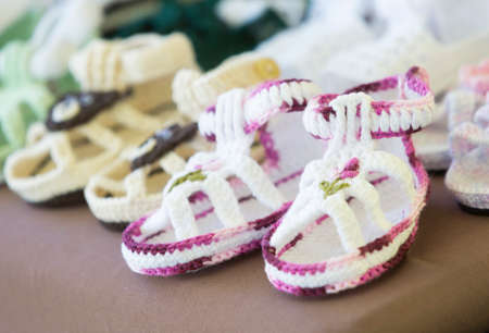sheep wool: Colorful handmade childrens slippers from sheep wool. Stock Photo