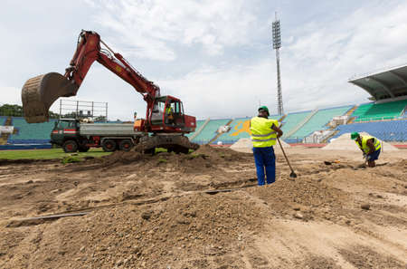 bagger: Sofia, Bulgaria - June 8, 2015: Workers are repairing Bulgarias national stadium Vasil Levski as part of its overall renovation.