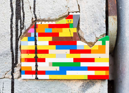 Sofia, Bulgaria - June 6, 2015: The artist Jan Vormann has filled the cracks in the exterior of a building in Sofia with Lego blocks as part of a city art festival.