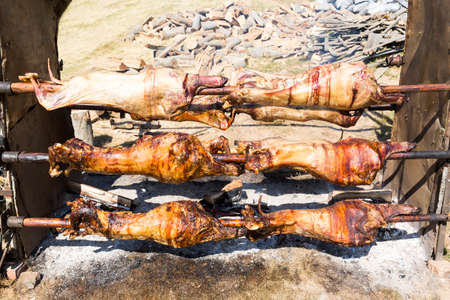 Traditional Bulgarian roasting lamb barbecue. It is roasted meat over an open fire, cooked in a special way. Most often the barbecue is prepared of a ram, lamb, goat or sheep and processed by the slasher.