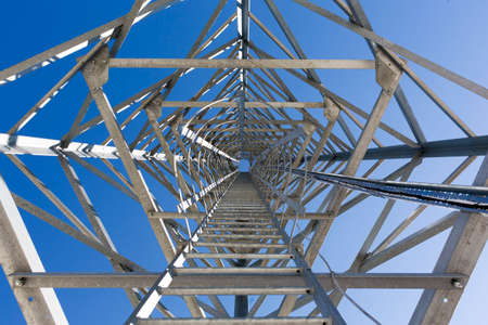 telecommunication: Ladders of a communication tower in the mountain designed to monitor with cameras and notify for fires. Stock Photo