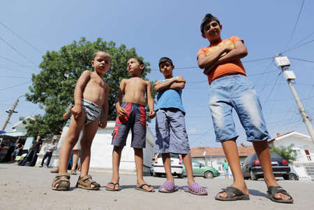 uneducated: Sofia, Bulgaria - July 30, 2015: Gypsies children are attending at the official opening of a center in their neighborhood for mothers and children in risk. Editorial