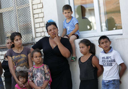 Sofia, Bulgaria - July 30, 2015: Gypsies mothers and their children are attending at the official opening of a center in their neighborhood for mothers and children in risk.
