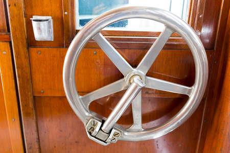 vaulted door: Locking mechanism inside of the door of an old train car.