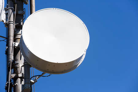 connect: Telecommunications tower against the blue sky. Antennas for television, radio, and mobile phones. Stock Photo