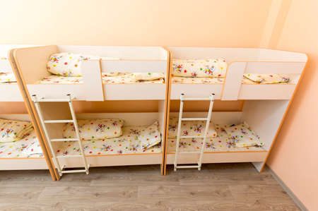 bunkbed: New kindergarten bedroom with small bunk beds with stairs for the kids.