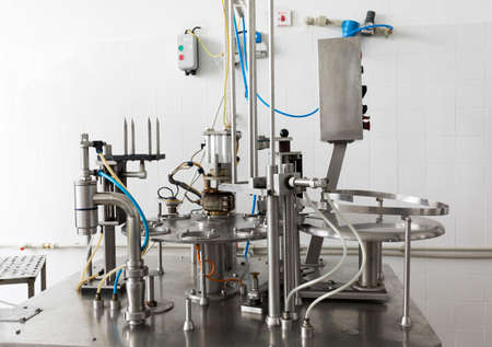 creamery: Cheese production device in a small family creamery. The dairy farm is specialized in buffalo yoghurt and cheese production. Stock Photo