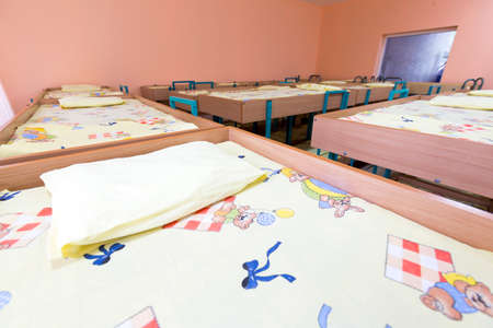 bunk: Kindergarten bedroom with small bunk beds with stairs for the kids. Stock Photo