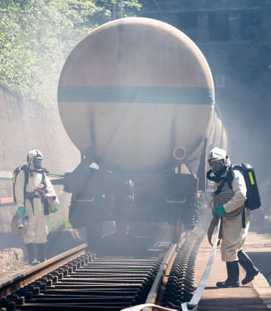 A team working with toxic acids and chemicals is approaching a chemical cargo train crash near Sofia, Bulgaria. Teams from Fire department are participating in an emergency training with spilled toxic and flammable materials.