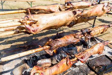 slasher: Bulgarian barbecue is a tradition of roasting meat over an open fire, prepared in a special way. Most often the barbecue is prepared from slaughtered ram lamb or sheep and processed by the slasher. Stock Photo