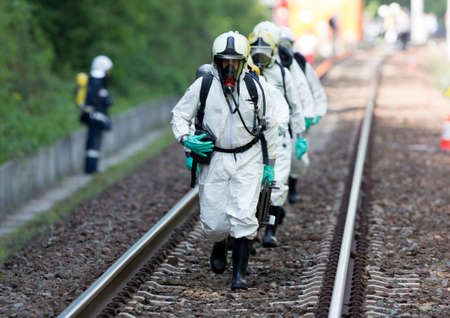 Sofia, Bulgaria - May 19, 2015: A team working with toxic acids and chemicals is approaching a chemical cargo train crash near Sofia. Teams from Fire department are participating in an emergency training with spilled toxic and flammable materials. Editorial