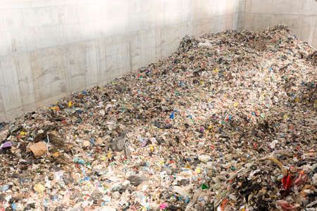 Waste-to-energy or energy-from-waste is the process of generating energy in the form of electricity or heat from the primary treatment of waste. Environmentally friendly, environment-friendly. Inside. Standard-Bild