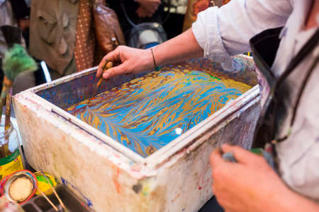 marbling: Paper marbling is a method of aqueous surface design, which can produce patterns similar to smooth marble or other stone. Ebru - The art of painting on the water.