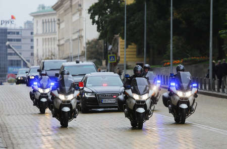 Delegation: Sofia, Bulgaria - October 15, 2015: Cortege of a Chinese delegation in Sofia. The cars of the diplomats are surrounded by policemen on police motorcycles. Editorial