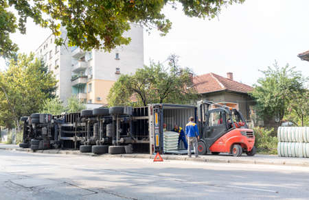 troyan: Troyan, Bulgaria - September 22, 2015: A view of the rear wheels of a overturned truck on a small street in an accident. Editorial