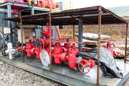 drilling machine: A drilling machine in a gas field. Close-up of the mechanism and parts of the platform.