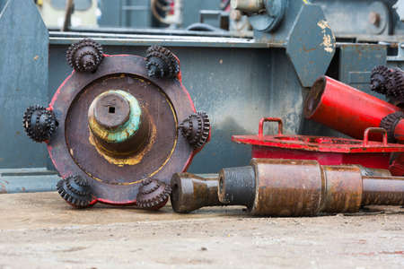drilling machine: A drilling machine in a gas field. Close-up of the head mechanism and parts of the platform.