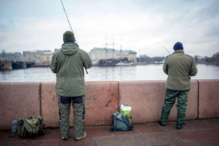two men: Two men are fishing in the Neva river in Saint Petersburg, Russia.