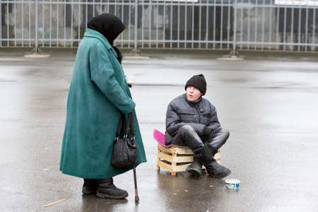 old people: Saint Petersburg, Russia - November 20, 2015: An old woman and a man are begging for money in front of a church in St. Petersburg, Russia. Editorial