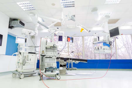 Operating room in a hospital building with modern equipment.