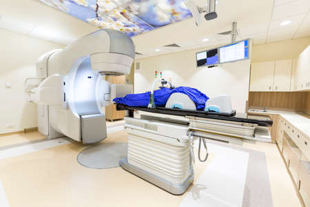 A radiation therapy for patients with caner. Modern cancer treatment in a new hospital. Imagens